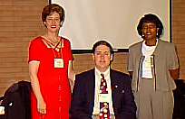Nancy Jacobs; Christ Wade, student computer expert; and teacher Annie Smith by Boyer Technology Summit in 1996