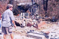 In the photo below, John Anderson, youngest son of Walter Anderson, surveys the destroyed property and art work. Photo by Paul F. Jacobs